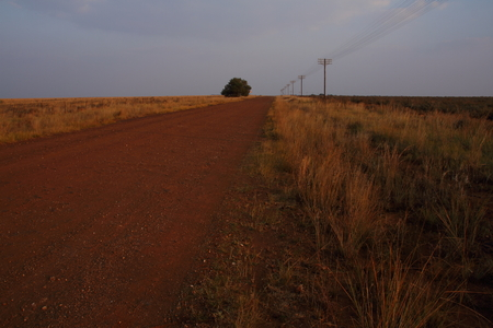 northwest africa: Power lines next to a rural dirt road in South Africa