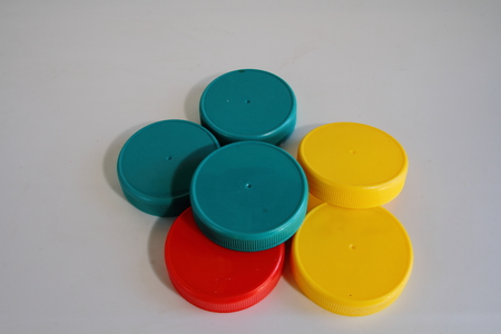 lids: Yellow, blue and red plastic lids