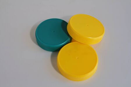 primary colours: Yellow and blue plastic lids