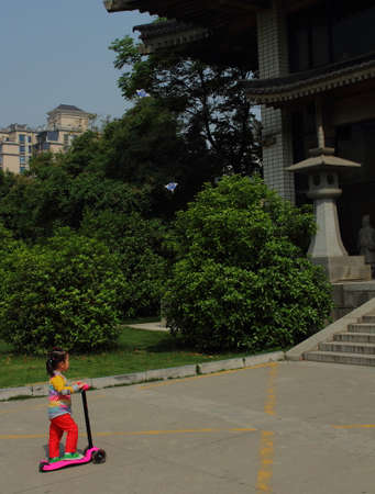 candid: Candid urban street photography - chinese child playing