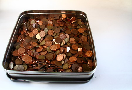 tin: Copper coins in a biscuit tin Stock Photo