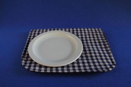 side plate: White side plate on a blue background