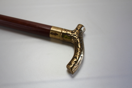 wooden stick: A walking stick with a brass head