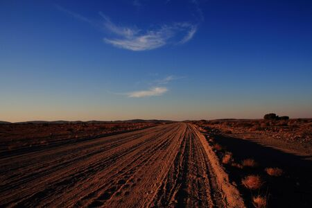 dusty: A dusty country road at sunrise Stock Photo