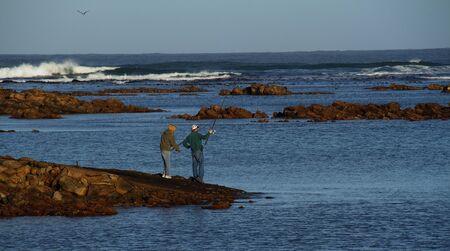 passtime: Fishermen at the sea
