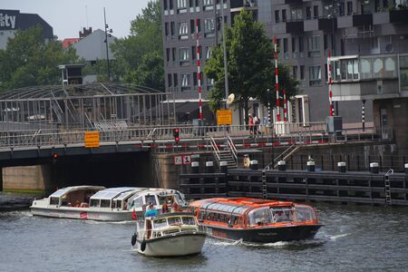 passtime: Family boating holiday activities Amsterdam Holland Editorial