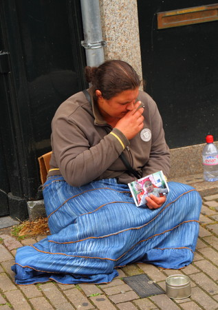 begging: A female refugee begging on the street Editorial