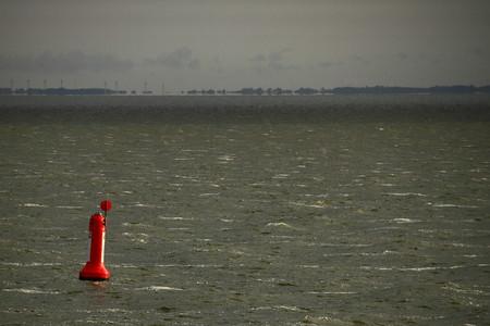 buoy: A red buoy on a grey sea