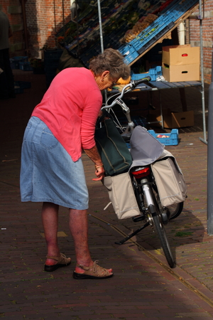 uses: Elderly woman uses bicycle transport
