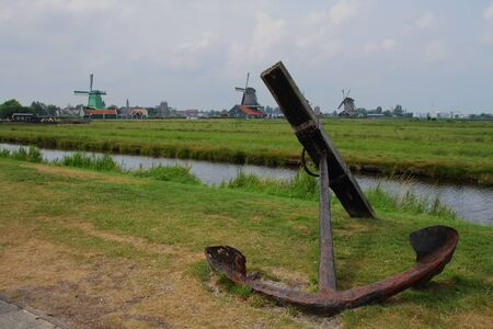 rusts: A rusted ships anchor and windmills