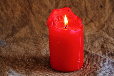 landscape format: Red candle with hessian background landscape format