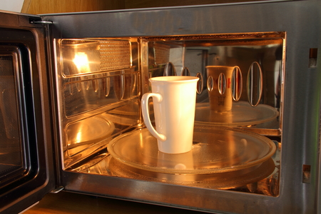 A cup in a microwave oven