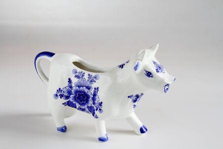 Ceramic porcelain white and blue ornamental cow Stock Photo