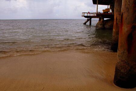 below: Beach sand below a jetty Stock Photo
