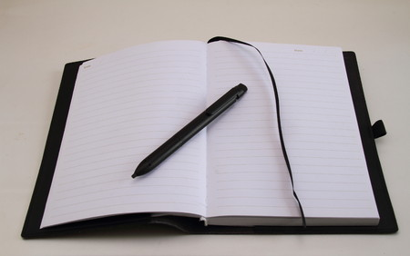 owes: Open note book with empty pages and a pen Stock Photo