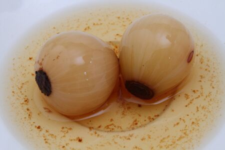 Pickled onions in vinegar - in a pickle