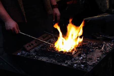 Irons in the fire - a blacksmith at work