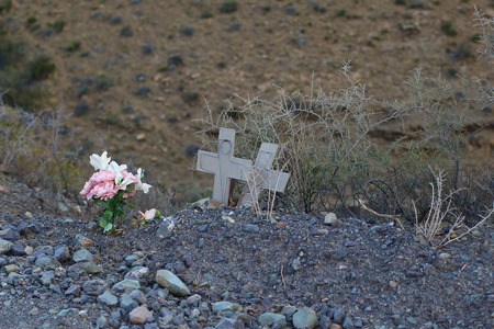 mva: Flowers and crosses mark the spot for victims of a fatal vehicle accident