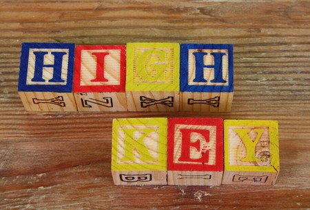 The term high key visually displayed using colorful wooden blocks