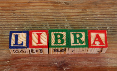The term Libra visually displayed using colorful wooden blocks