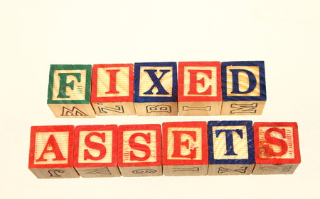 jargon: The term fixed assets displayed visually using colorful wooden to blocks