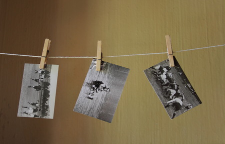 of yesteryear: Retro black and white photographs drying on a line after development in a darkroom