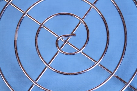 doldrums: Symmetry and patterns found in everyday household objects on a clear blue background with copy space