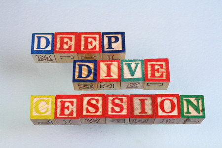 The term deep dive cession visually displayed on a white background using colorful wooden toy blocks in landscape format with copy space Reklamní fotografie - 85324302