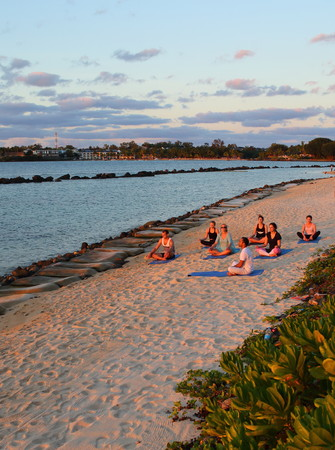 Turtle Bay, Mauritius - unidentified persons do yoga on the beach at sunset in portrait format with copy space Editorial
