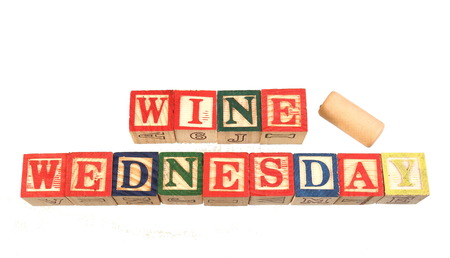 The term wine Wednesday visually displayed on a white background using colorful wooden toy blocks image in landscape format with copy space Stockfoto