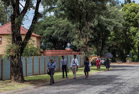 Johannesburg, South Africa - unknown members of the Jehovahs Witness sect work the streets of the city, image in landscape format Sajtókép