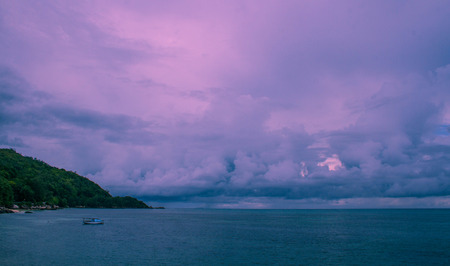Ultra-violet storm clouds over Praslin Island Seychelles image with copy space in landscape format