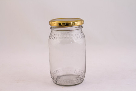 Empty clear glass jar isolated against a white background image with copy space in landscape format