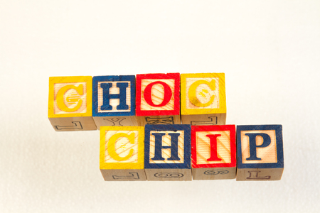 The term choc chip visually displayed on a white background using colorful wooden toy blocks image with copy space in landscape format