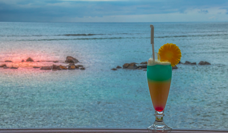 Cool cocktail at sunset against an out of focus background image with copy space in landscape format 版權商用圖片