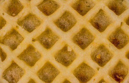 Geometric patterns - symmetry in everyday life objects - a close up image of a waffle with copy space