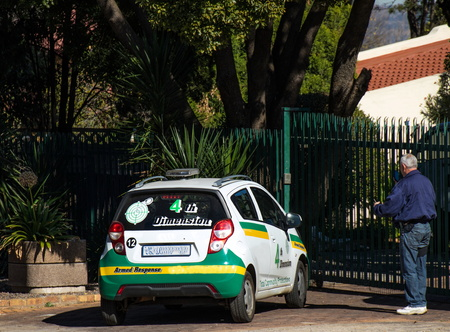 Johannesburg, South Africa - unidentified private security staff guard and check residential properties in the city in a time of high crime due to rife unemployment