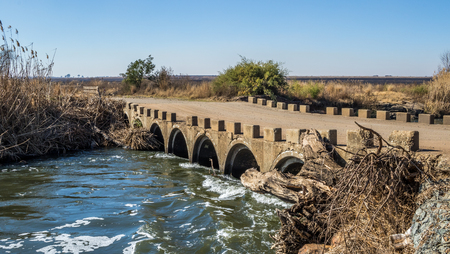 South African landscape of an old concrete low water bridge over the Klip River in Gauteng image with copy space in landscape format Imagens
