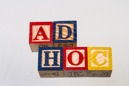 The term ad hoc displayed visually on a white background using colorful wooden toy blocks Imagens