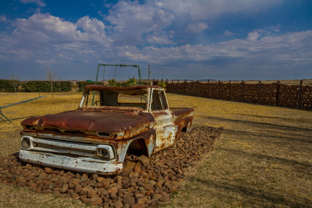 Old truck in an empty playground image with copy space in landscape format