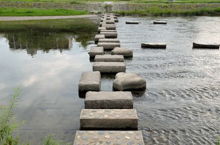 stepping: Kyoto kamogawa stepping stones Stock Photo