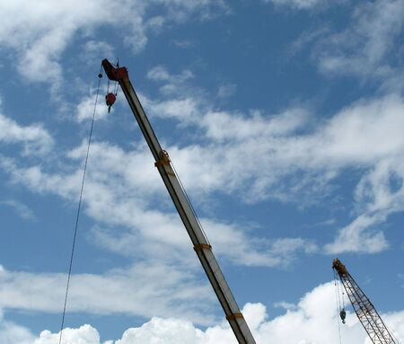Double construction crane against blue sky with lots of copyspace Stock Photo - 758090