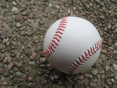 Single baseball lying on ground