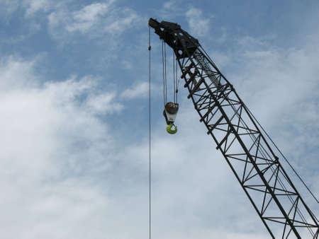 Construction crane against blue background Stock Photo - 3466891