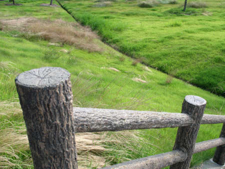 A wooden fence surrounded by Japanese field Stock Photo
