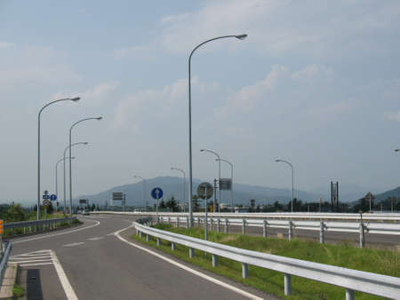 An empty highway in a little Japanese town