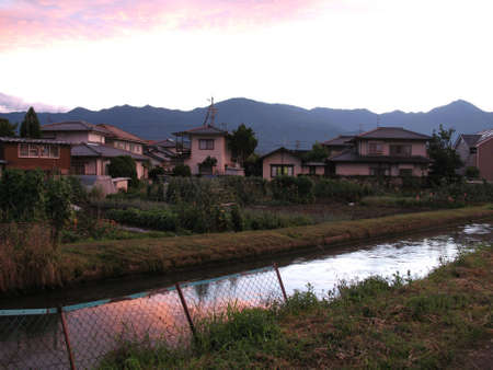 View of a rural Japanese village during sunset