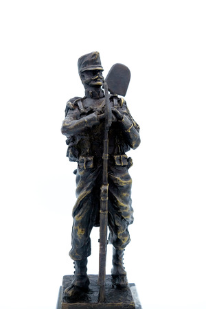 Bronze figurine of a Spanish soldier Sapper nineteenth century with a shovel and a rifle. Isolated Stock Photo