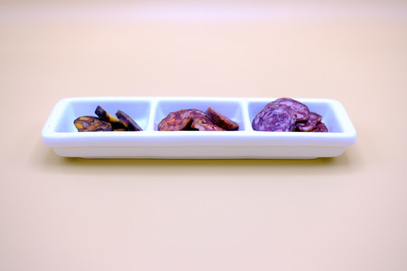 carnes: cut  sausage called in spanish chorizo morcilla salchichon,  typical of Spain. On a wooden board