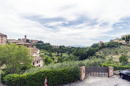 24: Siena, Tuscany, Italy. May 24, 2017. View of the fields surrounding Siena from the Market Square Piazza del Mercato